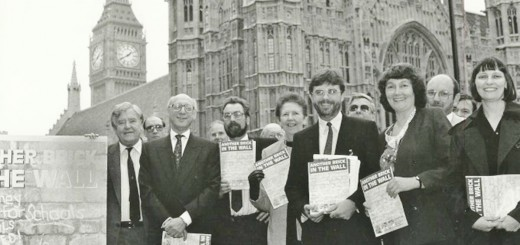 Councillors and officers holding Another Brick in the Wall documents in front of Houses of Parliament